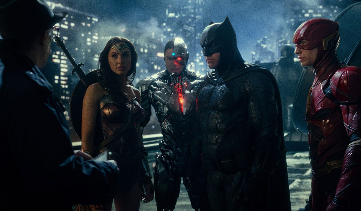 Left to right: J.K. Simmons, Gal Gardot, Ray Fisher, Ben Affleck, and Ezra Miller star in Justice League.